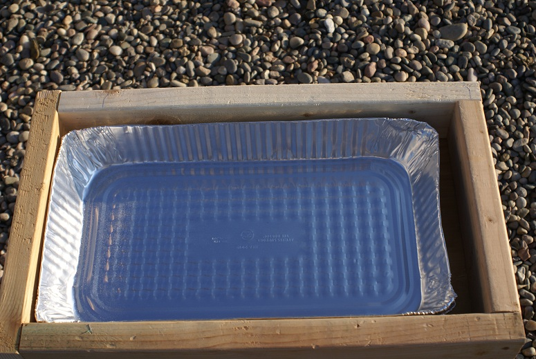 The box with the aluminum pan.